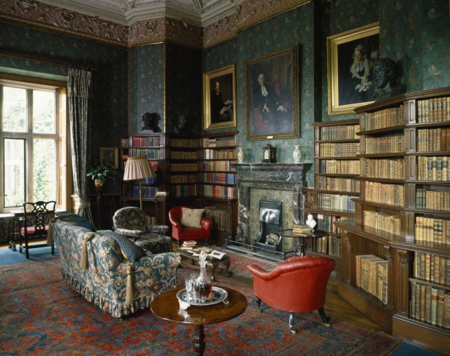 The Library at Dunster Castle, created by Salvin, 1870 - 1871. The nineteenth century wallpaper simulated embossed leather, and is known as Cordelova.